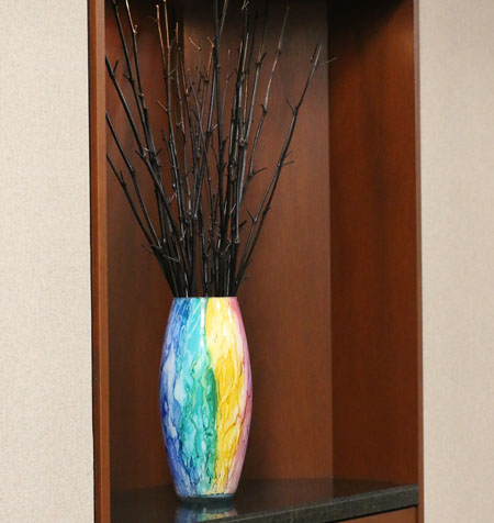 An image of the interior of the Steinberg Garellek office in Boca raton with rainbow vase.