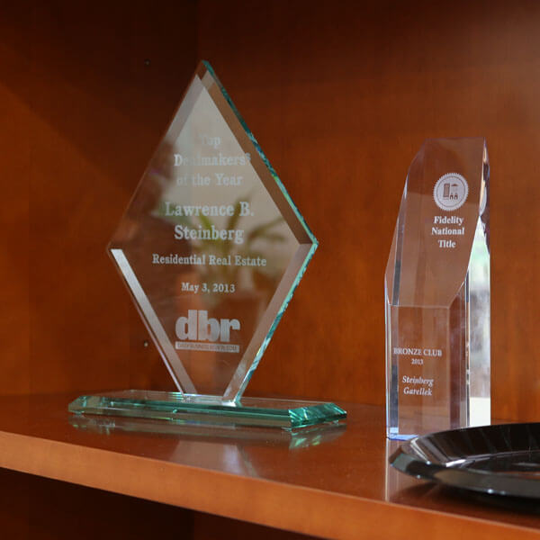 An image of business awards that links to the Business Law services provided at Steinberg Garellek.